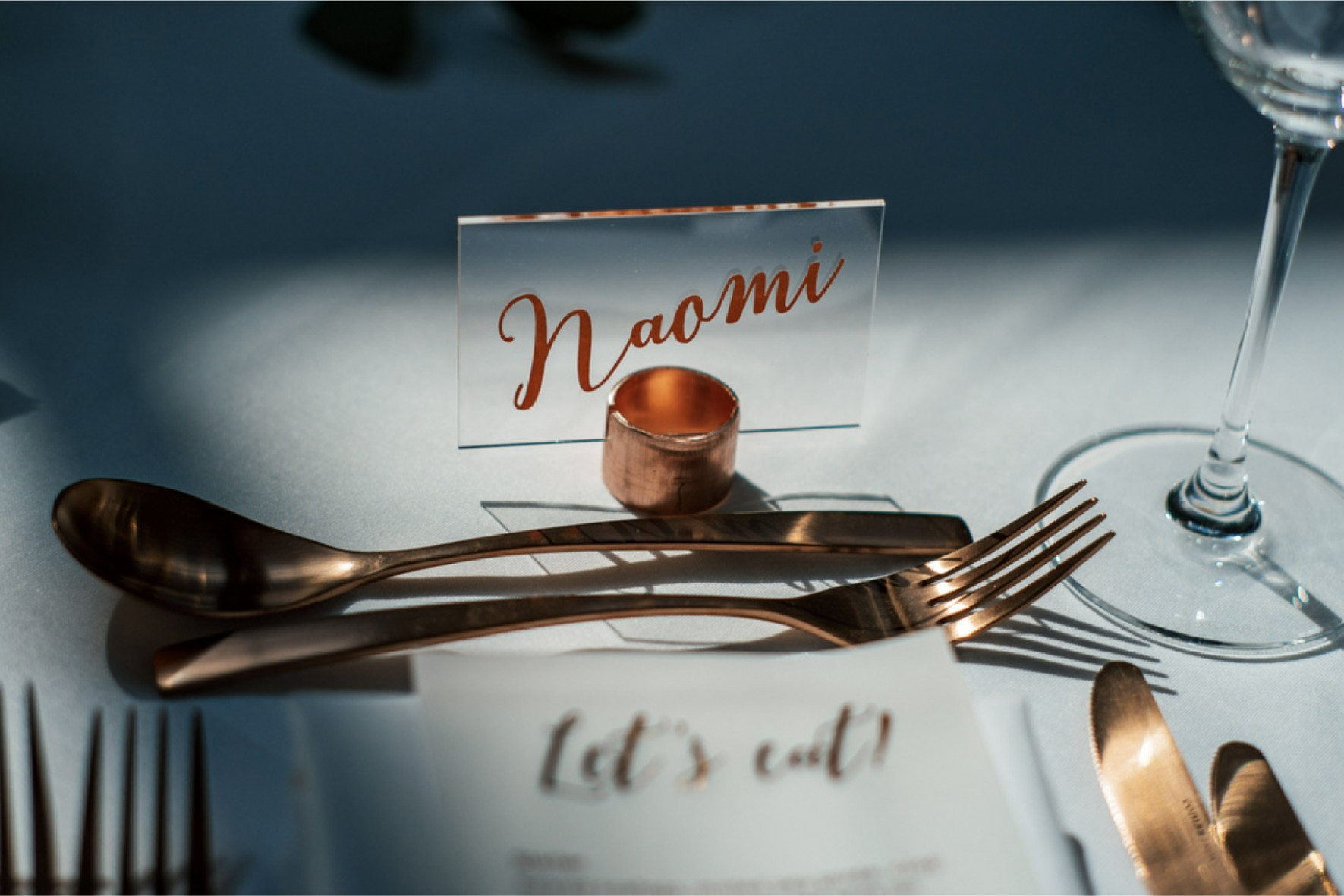 Clear acrylic place name in copper pipe stand with copper foil calligraphy vinyl lettering - stationery and styling by www.rosepaperscissors.com