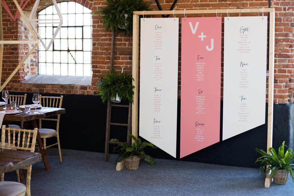 Geometric alternative wedding table plan- hanging wooden boards - wedding styling and stationery at Godwick Great Barn by www.rosepaperscissors.com