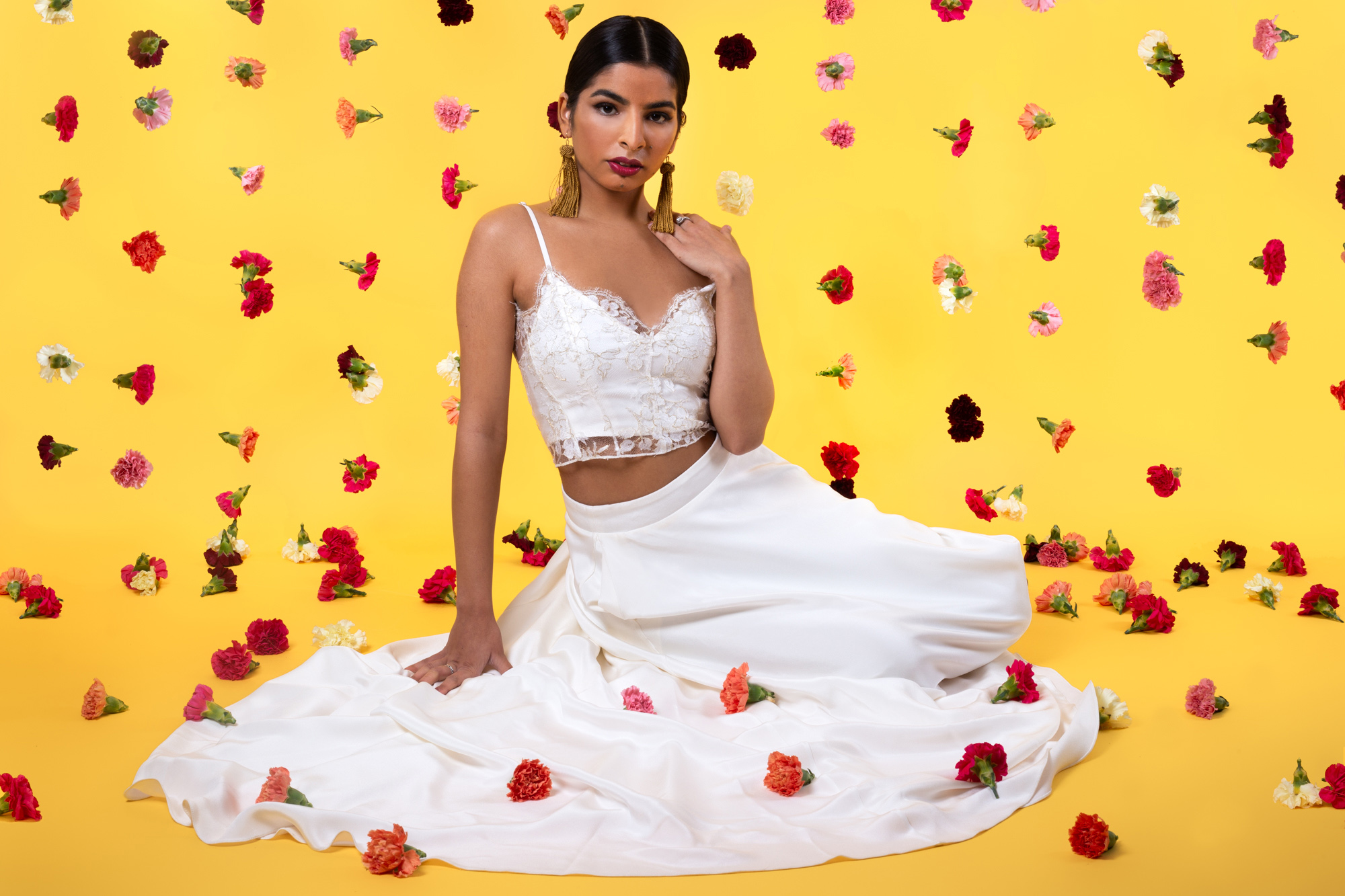 Modern Indian Inspired, untraditional, wedding styled shoot with hanging carnation curtain and house of ollichon bridal separates