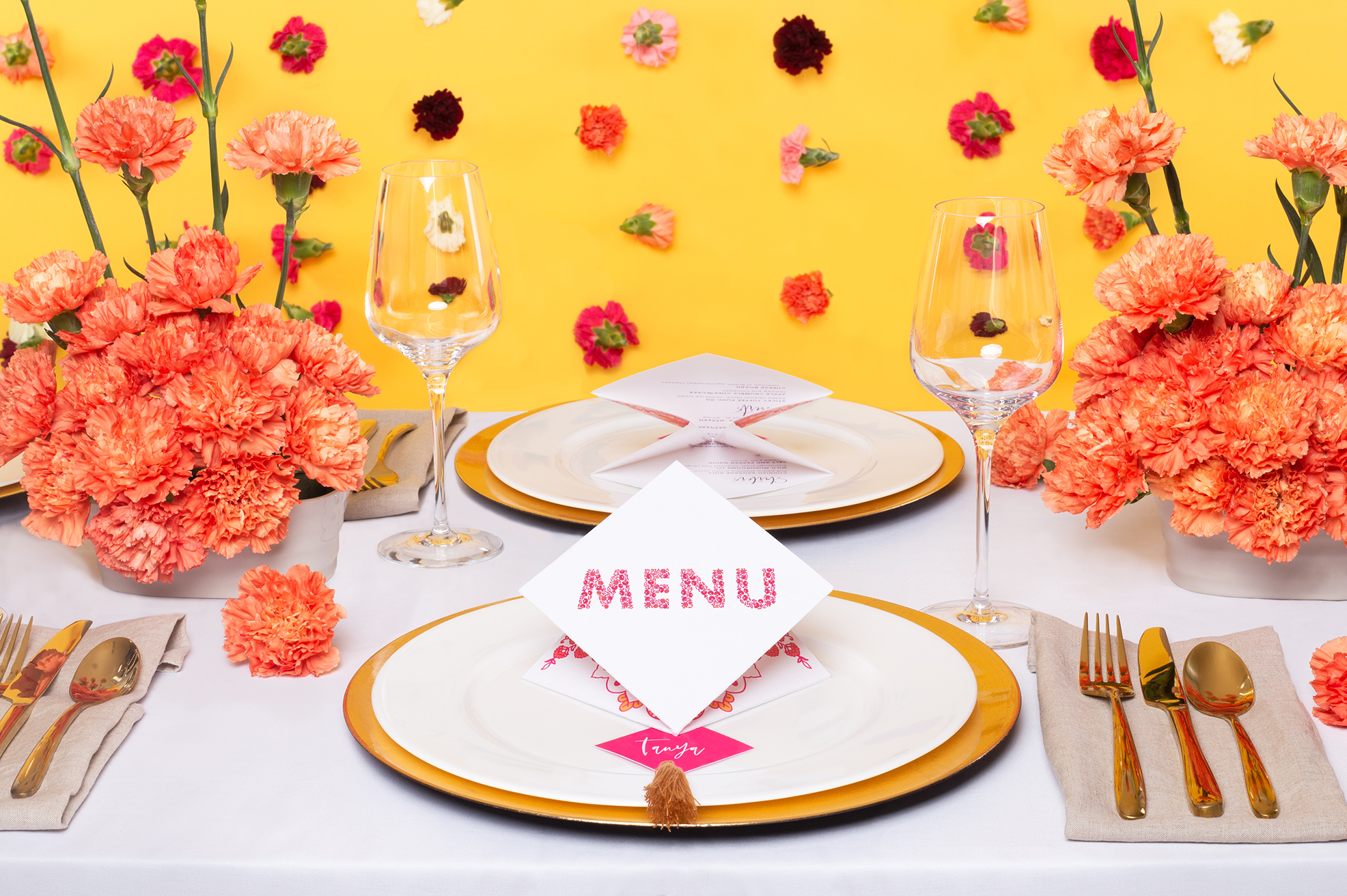 Modern Indian Inspired, untraditional, wedding styled shoot table styling and stationery carnation curtain, folded menu and place name with tassel